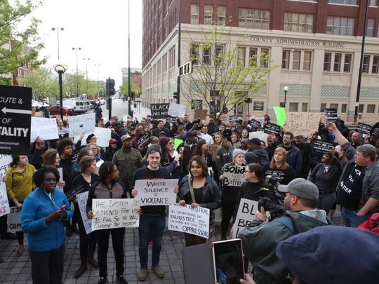 Protesters gather at the steps of the Hamilton County