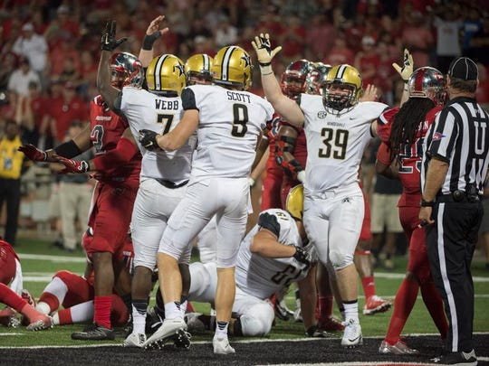 Vanderbilt running back Ralph Webb (7) cheers after scoring a touchdown against Western Kentucky in overtime last season.