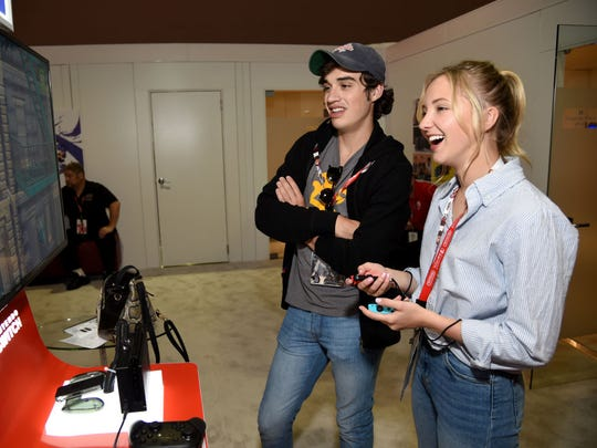 Actress Audrey Whitby (right) and actor Joey Bragg (left) play Super Mario Odyssey at the Nintendo booth at the 2017 E3 Gaming Convention at Los Angeles Convention Center on June 13, 2017 in Los Angeles, California.  (Photo by Michael Kovac/Getty Images for Nintendo)