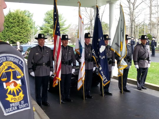 Manchester Police honor Officer Scott R. Thompson, who was posthumously promoted to corporal.