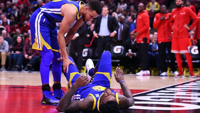 Golden State Warriors forward Jordan Bell (2) goes down with an injury during the first half at the United Center.