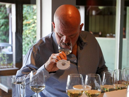 Scott Stephens, of Southern Rail, tastes a white wine at The Arizona Republic Wine Competition at Tarbell's in Phoenix,  Arizona on October 26, 2015. (Photo by Ben Margiott/The Republic)