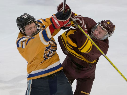 Saturday night was a chippy ACHA game between Schoolcraft and CMU, as evidenced by this play in the neutral zone. Schoolcraft's Nick Oliveri (left) collides with a Chippewas player.