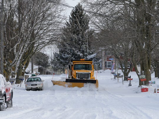 A city plow clears Galax Drive after a spring snowstorm hit the area Wednesday, Apr. 4, 2018, in Manitowoc, Wis. Josh Clark/USA TODAY NETWORK-Wisconsin