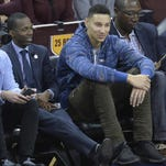 No. 1 draft pick Ben Simmons (center) sits courtside at a Cavs game next to agent Rich Paul.