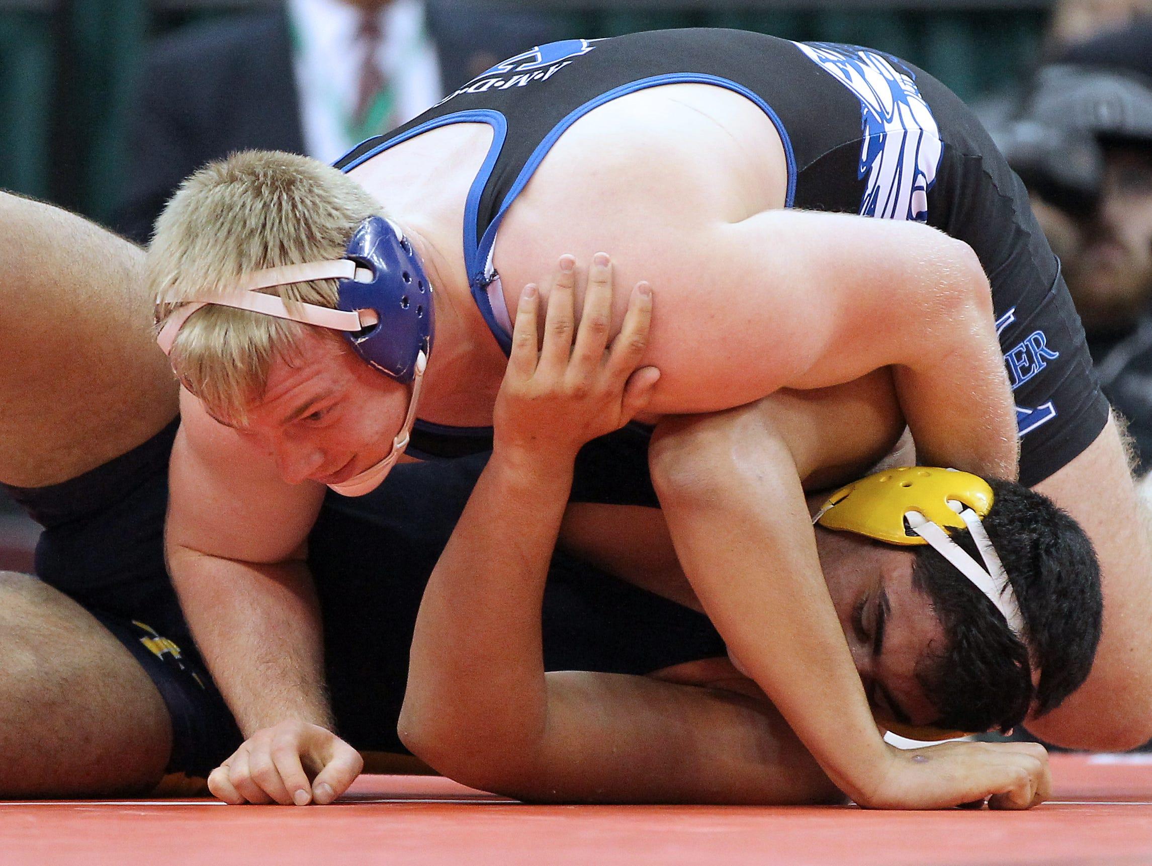 St. Xavier senior Cole Jones lays on top of opponent Noel Carabello.