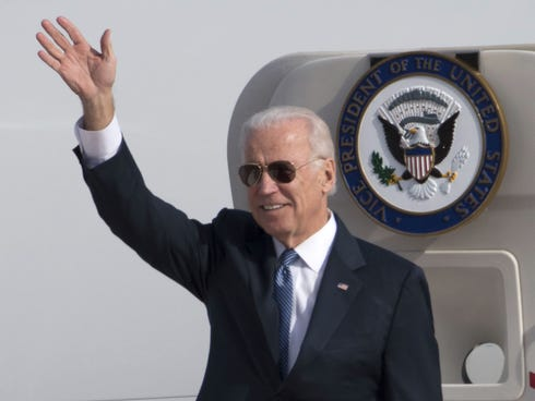 U.S. Vice President Joe Biden waves as he walks out of Air Force Two at the airport Dec. 4, 2013 in Beijing, China.