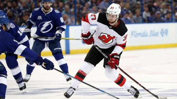 New Jersey Devils center Pavel Zacha (37) passes the puck against the Tampa Bay Lightning during the second period of game one of the first round of the 2018 Stanley Cup Playoffs at Amalie Arena.