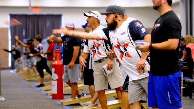 Cornell players toss bean bags during one of the rounds of the Texas Cornhole League State Championship on Saturday, June 24, 2017, at the Abilene Convention Center.