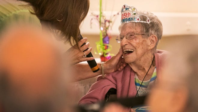 Paula Gervais sings to Mary Sawyer at her 105th birthday party on Friday, May 26, 2017, at Calusa Harbour in Fort Myers.