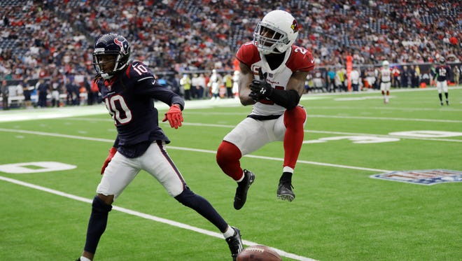 Arizona Cardinals cornerback Patrick Peterson (21) reacts after breaking up a pass intended for Houston Texans wide receiver DeAndre Hopkins (10) during the second half of an NFL football game Sunday, Nov. 19, 2017, in Houston.