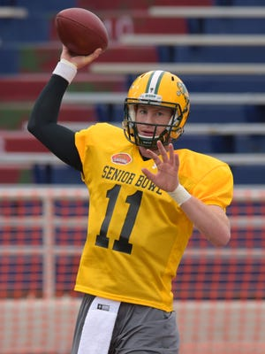 North Dakota State quarterback Carson Wentz of North Dakota State (11) attempts a pass  during Senior Bowl practice at Ladd-Peebles Stadium.