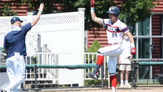 Brockton Rox Joe Bramanti hits a two-run home run and does a social distance high-five to head coach Andy Theriault against the Worcester Bravehearts at Campanelli Stadium on Saturday, August 8, 2020.