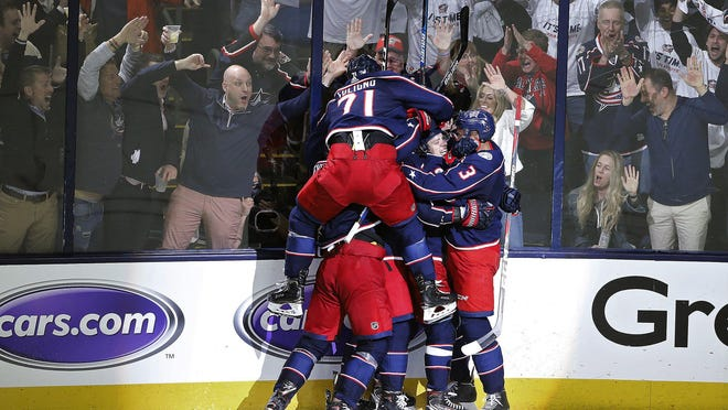 """Nick Foligno jumps onto his celebrating teammates after the series-clinching goal in  Game 4 of the Blue Jackets' series against the Lightning last season. """"Don't take (making the playoffs) for granted,"""" Foligno said, """"because you just don't know how many opportunities you're going to get."""""""