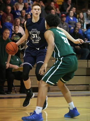 Colonel Crawford's Heath Starkey, guarded by Ontario's Jackson Todd, looks to drive to the hoop in Wednesday night's all-star classic.