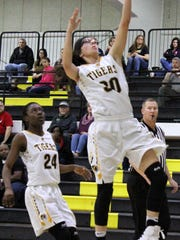 Alamogordo's Faith Silva, right, makes an easy layup during the second half Friday night.