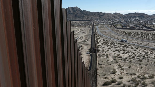 "In this Wednesday, Jan. 25, 2017 photo, a truck drives near the Mexico-US border fence, on the Mexican side, separating the towns of Anapra, Mexico and Sunland Park, New Mexico.  U.S. Customs and Border Protection said Friday, Feb. 24, 2017 that it plans to start awarding contracts by mid-April for President Donald Trump's proposed border wall with Mexico, signaling that he is aggressively pursuing plans to erect ""a great wall"" along the 2,000-mile border."