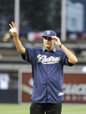 Pitcher Zach Eflin of the San Diego Padres waves to the crowd before throwing out the ceremonial first pitch before a baseball game against the St. Louis Cardinals at Petco Park on September 10, 2012 in San Diego, California.  (Denis Poroy/Getty Images)
