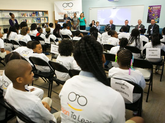 Vision to Learn, which provides free vision care to children, presents glasses to about 60 children at Kuumba Academy and Great Oaks Charter School.