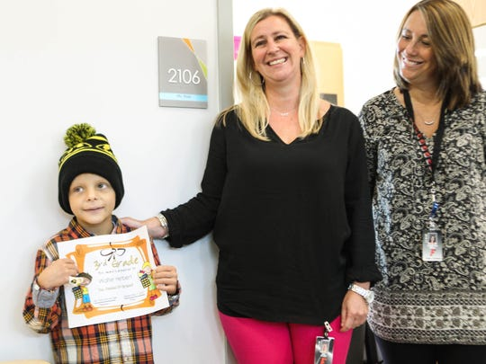 """Walter """"SuperBubz"""" Herbert completes multiple grades of school in one day at Fairfield Central Elementary school on Thursday, Sept. 7, 2017. Walter graduates third grade with teachers Kristen Bell (right) and Maria Post."""