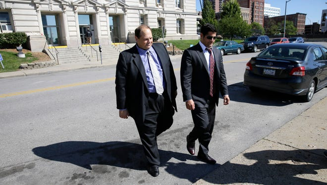 Former lottery security officer Eddie Tipton, left, leaves the Polk County Courthouse after sentencing Wednesday, Sept. 9, 2015, in Des Moines, Ia.
