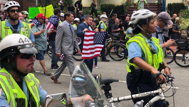 Unite the Right organizer Jason Kessler walks in Washington, D.C., on Aug. 12, 2018.
