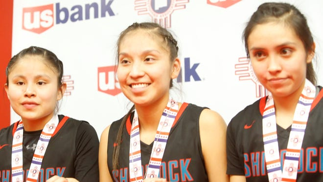 From left, Shiprock seniors Melanie Secody, Tanisha Begay and Paige Dale answer questions at a post-game press conference Friday at The Pit in Albuquerque.