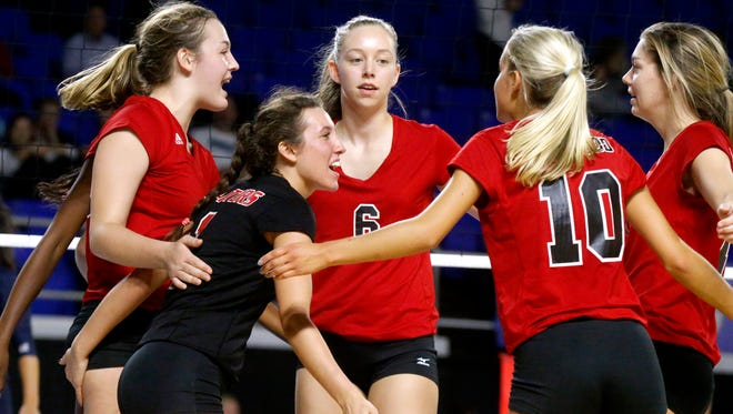 Ravenwood players celebrate a point during the TSSAA Class AAA State GirlsÕ Volleyball Tournament against Siegel, on Wednesday, Oct. 18, 2017, at MTSU.