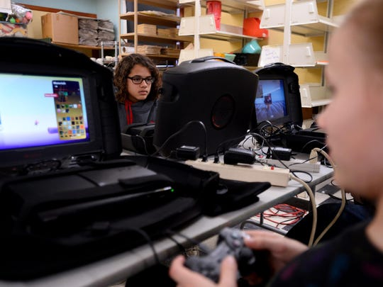 Mya Curtis, age 14, designs game levels in LittleBigPlanet.