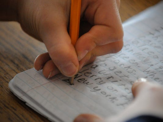 kid writing.jpg