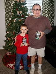 Dave Blackburn and his 8-year-old grandson, Hunter Blaylock, made a project out of collecting for the Penny Drive.