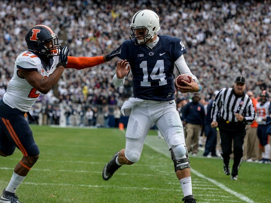 Penn State Nittany Lions quarterback Christian Hackenberg (14) runs into the end zone for a receiving touchdown as he's pushed by Illinois Fighting Illini defensive back Eaton Spence (27) as Penn State beat Illinois 39-0 at Beaver Stadium on Saturday, October 31, 2015. Jeremy Long -- Lebanon Daily News