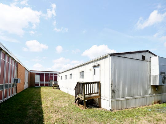 Two of six modular classrooms are shown at Dover Area Intermediate School in Dover, Thursday, Aug. 4, 2016. Dawn J. Sagert photo