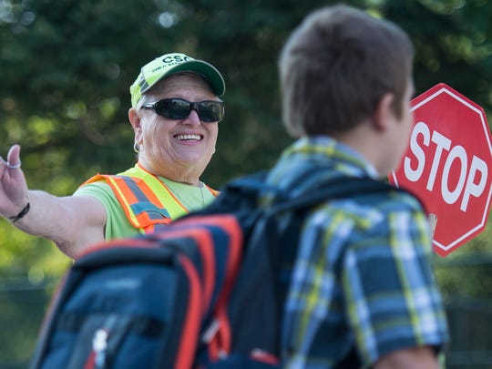 Carolyn Eisenhauer has been a crossing guard for 14 years and greets the children heading to Annville Elementary School by saying 'good morning' and 'have a good day.' On Monday, Aug. 29, 2016, she added 'welcome back' as it was the first day of classes for the school at 205 S. White Oak St. Annville