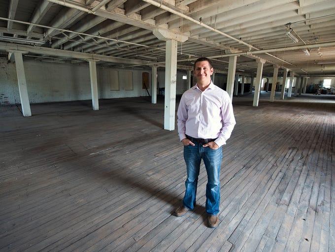 Matt Steinkamp, standing on an upper floor that will