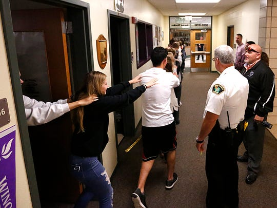 Area police and Waupun High School officials watch as a classroom full of kids are evacuated during a simulated lock down/evacuation Thursday October 5, 2017 at the Waupun High School. The school has been partnering with the Waupun Police Department for six years to train for a shooting event like those that have happened at other places throughout the country in previous years. Doug Raflik/USA TODAY NETWORK-Wisconsin