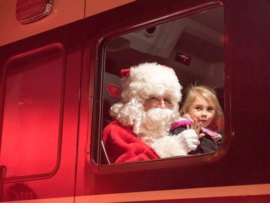 Seven-year-old Chloe Hoard arrives in a fire truck