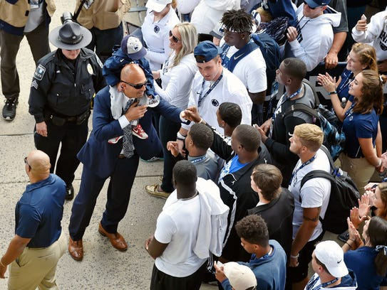 James Franklin meets and greets fans and recruits as he enters Beaver Stadium before the Pitt game last September.
