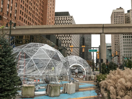 Igloo structures are erected as part of a winter scene