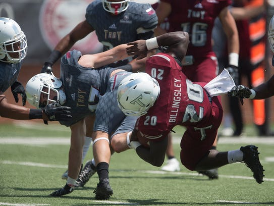 Troy wide receiver Sam Letton (17) tackles Troy running