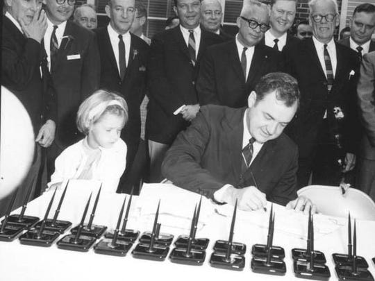 Governor Claude Kirk signing the Disney bill in 1967,