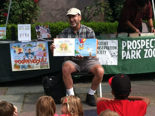 Aurthor Artie Bennett is shown at a children's book reading at Prospect Park Zoo.
