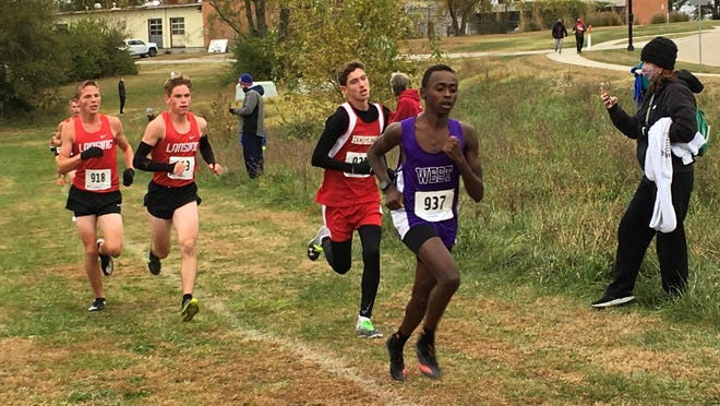Topeka West sophomore Lenny Njoroge (937) and Shawnee Heights freshman Jackson Esquibel, back right, lead the pack in Saturday's Class 5A boys regional cross country race.