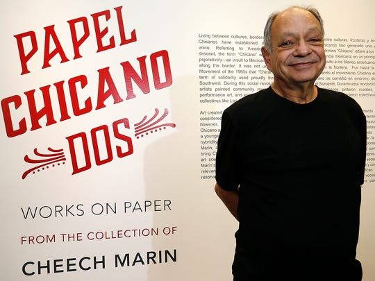 Actor, comedian and philanthropist Cheech Marin stands in front of the billboard announcing his Papel Chicano Dos: Works on Paper from the Collection of Cheech Marin, during a press conference Saturday. The exhibit is open to the public through June 17 at the El Paso Museum of Art. The exhibit, featuring 65 works from Marin's private collection, explores the Chicano identity from the Chicano Revolution to the present day. Marin is dedicated to bringing Chicano art to the forefront of the American art scene. This is the first time this exhibition is being displayed in the state of Texas.