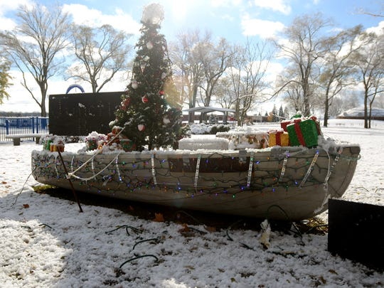A boat decorated with a Christmas tree put together by the Juction Buoy is displayed Monday, Nov. 16, at Marysville City Park.