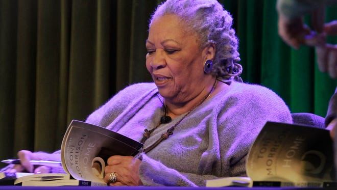 Author Toni Morrison signs copies of her book, Home, during Google's online program series, Authors At Google, on Feb. 27 in New York.  (