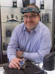 Wael Mokhles repairs and refurbishes old watches and sells new watches at On Time Watch Experts, in Plymouth.