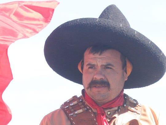 Rafael Celestino, posing as Pancho Villa, rode into