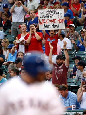 Rangers fans hold up a sign for Josh Hamilton during his first at-bat.