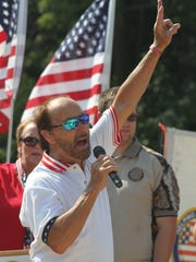 Scott and Laura Schroeder were officially presented keys to their new home Sunday by the Helping a Hero organization and special guest Lee Greenwood.